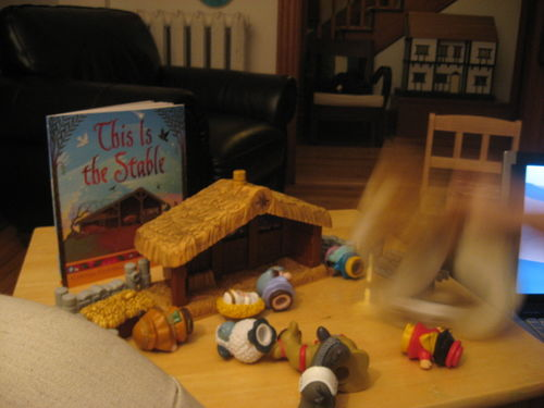 Giant -cat-attacks-little-people-manger