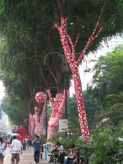 Red-and-white-polka-dot-tree-trunks-yayoi-kusama