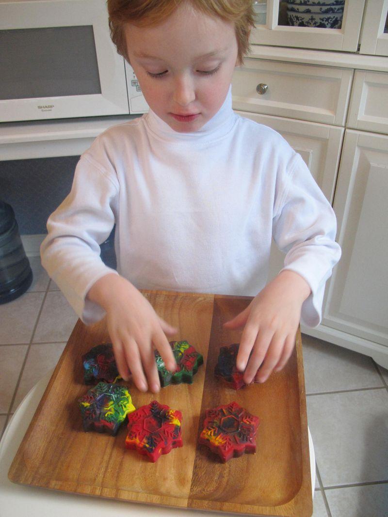 Luke-arranges-crayon-snowflake-ornaments