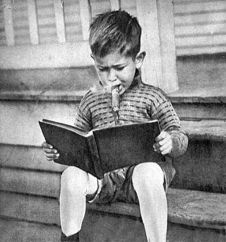 The-forward-boy-reading-a-book-and-smoking-a-cigar